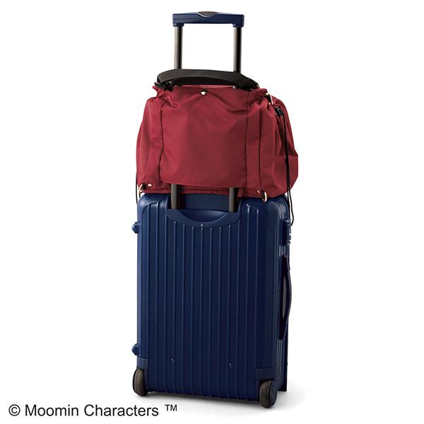フェリシモレジカゴリュックリトルミイの旅行での使い方。キャリーバッグにセットして使うことができます。
